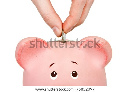 Savings - Piggy bank and hand with coin