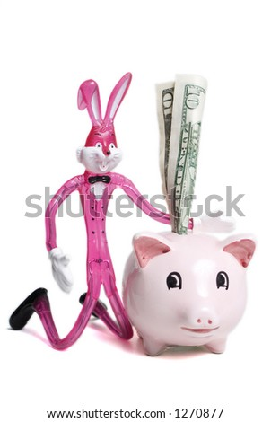 Savings piggy bank with Bunny rabbit putting 10 dollar bill