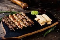 Savory lamb kebab served with pita bread. Authentic greek cuisine. Mediterranean cuisine set of kebab on wooden board rustic style