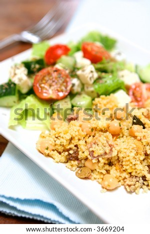 Savoury cous cous with raisins, nuts and chick peas served with fresh greek salad of feta cheese, cucumber, romaine lettuce, cherry tomatoes and sprinkling of dried oregano.