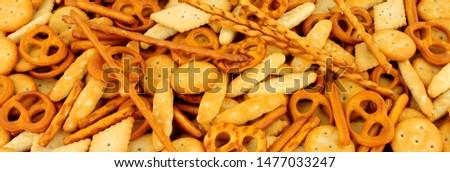 Savoury pretzel and cracker snack mix background