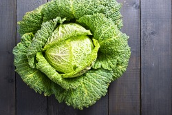 savoy cabbage from organic grower farm, on black wooden table