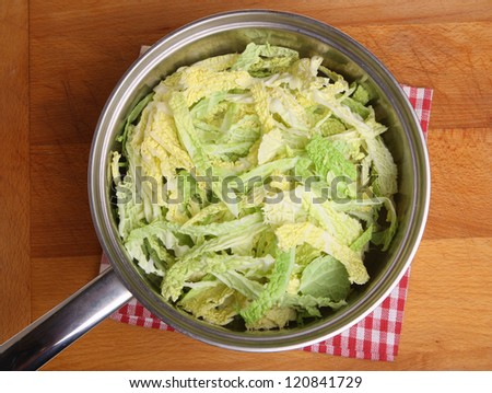 Savoy cabbage in stainless steel saucepan.
