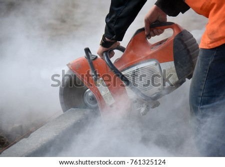 Sawing concrete curbs for road construction