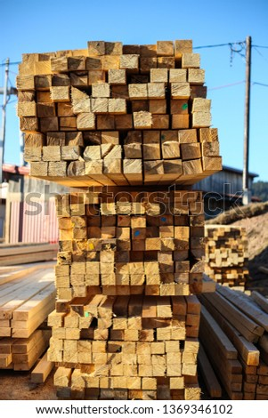 Sawmill.Wooden products cut out on sawmill, complex and awaiting distribution for markets.-Image #1369346102