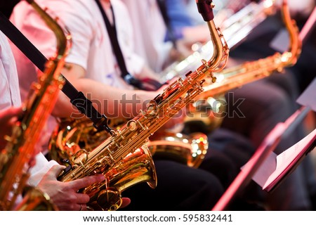 Saxophone in the hands of a musician in an orchestra closeup  Сток-фото ©
