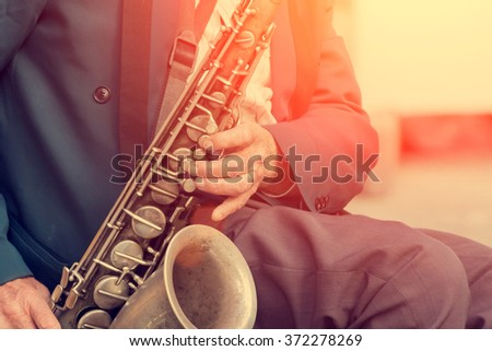 Saxophone in the hands of a street musician
