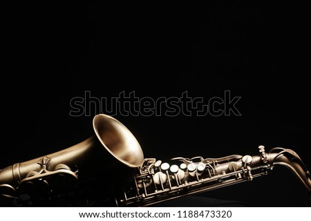 Saxophone jazz instruments. Alto sax isolated. Saxophone music instrument closeup on black