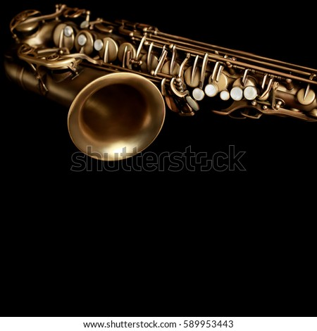 Saxophone jazz music instrument Sax close up isolated on black background Closeup detail of saxophone alto