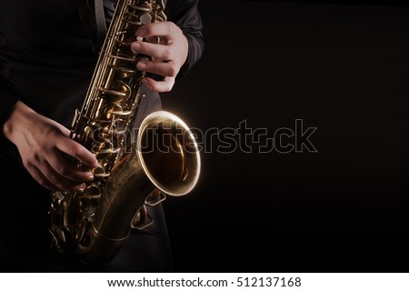 Saxophone Player hands Saxophonist playing jazz music. Alto sax musical instrument closeup