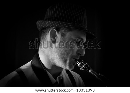 Saxophonist Series: close-up of the musician while playing. - stock photo