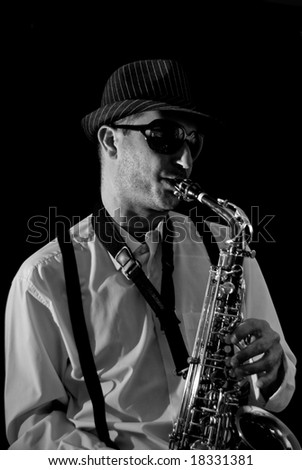 Saxophonist Series: Musician playing in black background