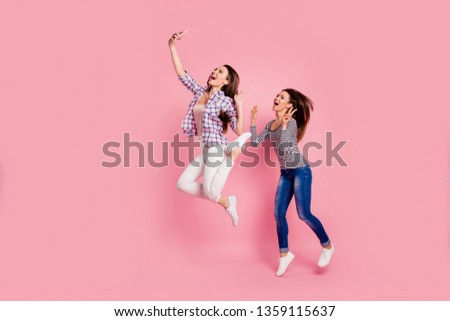 Say hi! Full length body size photo of positive students girl bloggers have free time rest video call laugh scream blogging show make v-sign wear blue jeans bright shirts isolated on pink background