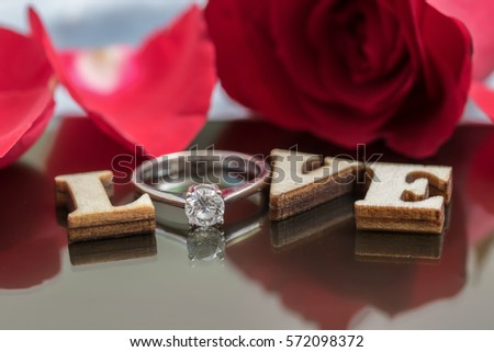 Say love via diamond ring and red rose to your lovers in Valentine's Day.