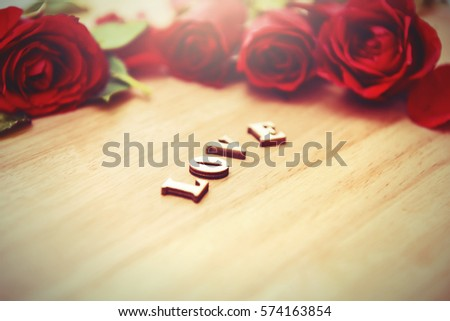 Say love via diamond ring and red rose to your lovers in Valentine's Day on wood background. Love is all around.I do loving you all day and night. Love digital concept.