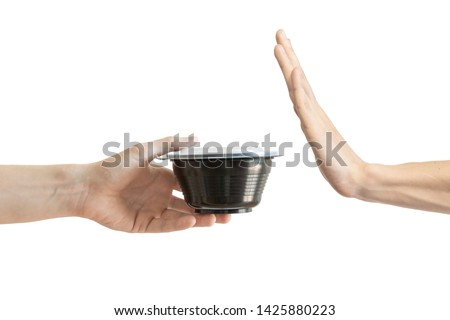 Say no to single use plastic. A black food container. Refused single use plastic. Hand gesture rejects single-use plastic