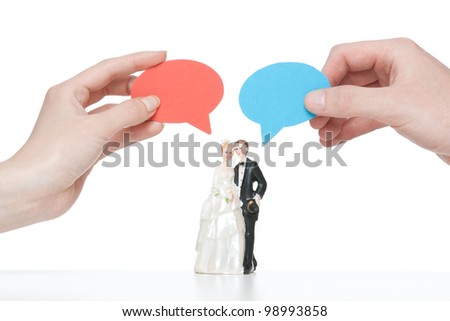 Say yes - wedding figurines (bride and groom) with cartoon bubble hold i hand by real woman and man.