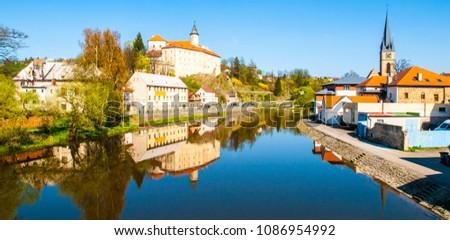 Sazava River in Ledec nad Sazavou. Panoramic view with Ledec Castle and town centre.