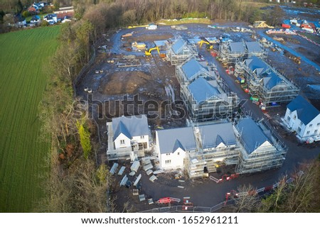 Scaffold at construction of new houses in residential building site UK