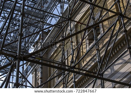 scaffolding against the backdrop of historical buildings - Shutterstock ID 722847667