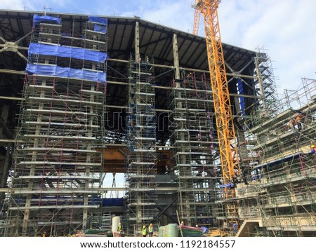 Scaffolding is used as a temporary structure to support building structures during construction. Power Plant. #1192184557