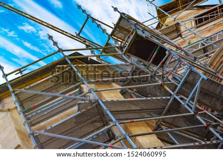 Scaffolding near the ancient St. Vitus Cathedral established for reconstruction and repair
