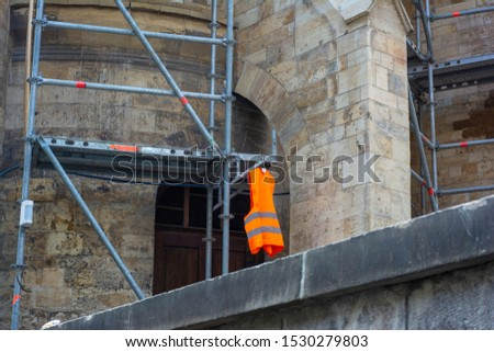 Scaffolding near the old cathedral installed for reconstruction and repair