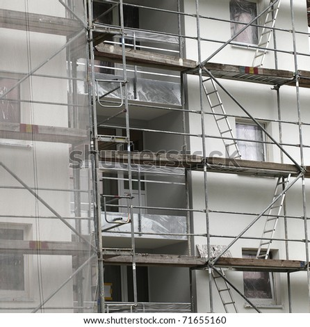 scaffolding on a building wall. building getting a new paint.