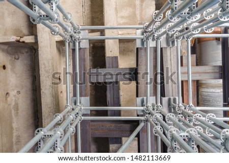 Scaffolding with a support system of beams at the reconstruction of the bridge