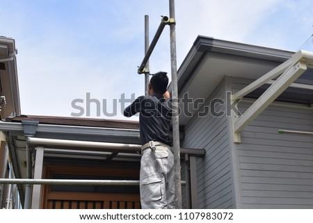Scaffoldingof house painting #1107983072