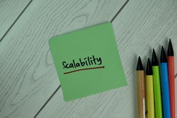 Scalability write on sticky notes isolated on Wooden Table.