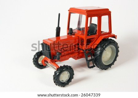 Scale metal collection model of an agricultural wheeled tractor on white background
