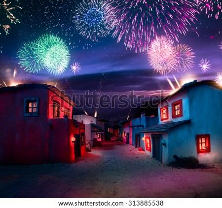 scale model of a mexican town at twlight with fireworks #313885538