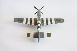 Scale model of the airplane fighter on a light background. Toy