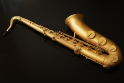 Scale model saxophone isolated on black background. Studio shot. 3d rendering, printing, graphic resources, copy space. Musical instrument, melody, jazz, orchestra, concert, culture. Hobby, collecting