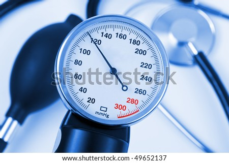 Scale of pressure and stethoscope - abstract medical background - stock photo