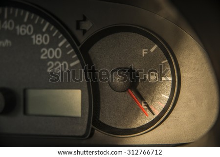 Scale of speed meter on car Auto rapprochement - at zero Sunset yellow light on black plastic texture Automobile inside interior
