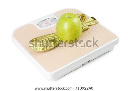 Scale, tape and apple on white background