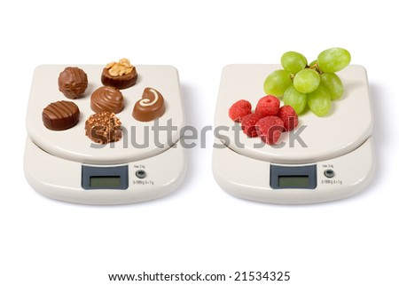 Scale with fruits and junk food isolated over a white background.