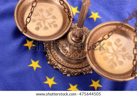 Scales of justice and Flag of European union , European union law concept. #475644505