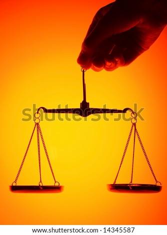 scales on orange light background