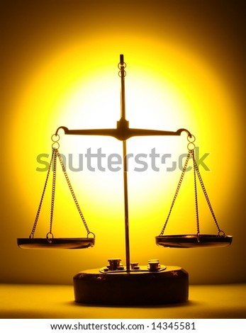 scales on yellow light background - stock photo