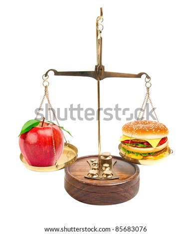 Scales with red apple and a hamburger.