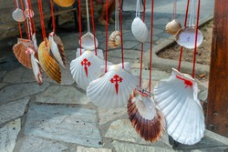 Scallop Shell, symbol of Camino de Santiago Walking path in Europe. Famous Camino de Santiago walking road and street. Pilgrims ways. The Way of Saint James pilgrimage