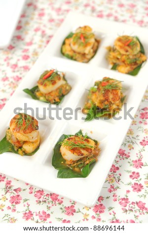 Scallops on a plate decorated