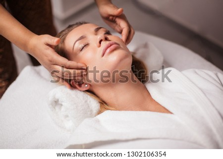 scalp massage. anti-stress facial massage. girl resting in a luxury spa resort Сток-фото ©