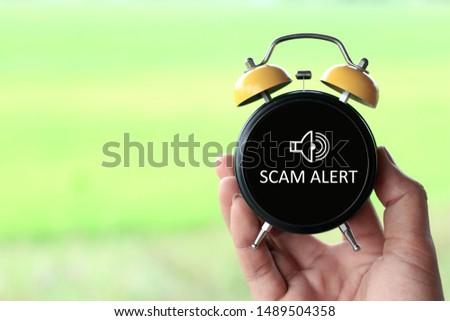 Scam Alert concept on analog clock #1489504358