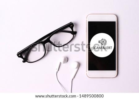 Scam Alert concept on smartphone screen #1489500800