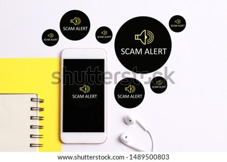 Scam Alert concept on smartphone screen #1489500803