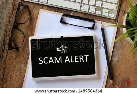 Scam Alert concept on tablet screen #1489504364
